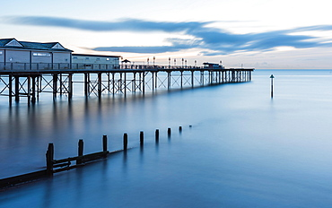 Sunrise in long time exposure of Grand Pier, Teignmouth, Devon, England, United Kingdom, Europe