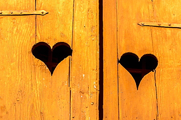 Hearts on a wooden window, France, Europe