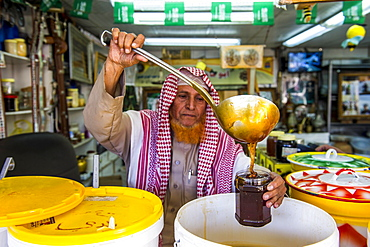 Men selling honey, Souk in Abha, Saudi Arabia, Asia