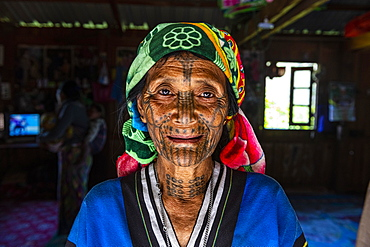 Chin woman with spiderweb tattoo, Mindat, Chin state, Myanmar, Asia
