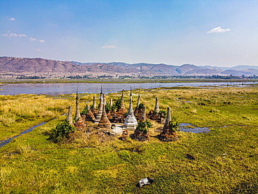 Aerial of little pagodas sitting in the waters of the southern Inle lake, Nyaungshwe, Shan state, Myanmar, Nyaungshwe Township, Shan State, Myanmar, Asia