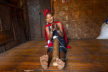 Old Kayah woman playing local instrument, Kayah village, Loikaw area, Kayah state, Myanmar, Asia