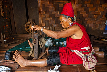 Old Kayan women weaving the traditional way, Kayah village, Loikaw area, Kayah state, Myanmar, Asia