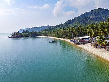 Aerial of a Moken, sea gypsy village on a white sand beach, Mergui or Myeik Archipelago, Myanmar, Asia