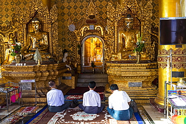 Pilgrims praying in the Shwedagon pagoda, Yangon, Myanmar, Asia