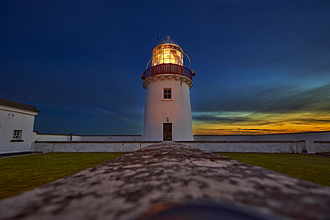 St. John`s Point lighthouse at dusk, with luminous light on, St. John`s Point, County Donegal, Ireland, Europe