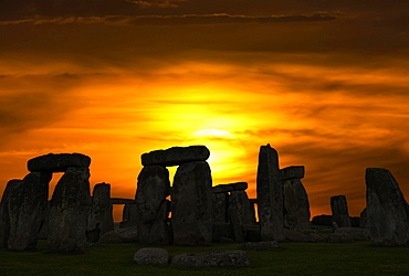 Silhouette of Stonehenge against evening sky with setting sun, Salisbury, England, Great Britain