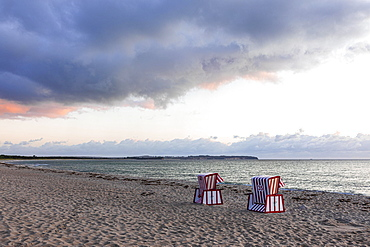 Lonely beach chairs in the morning light at the big beach of Thiessow, island Ruegen, Baltic Sea, Mecklenburg-Western Pomerania, East Germany