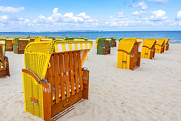 Closed beach chairs at the beach of the seaside resort Binz, island Ruegen, Baltic Sea, Mecklenburg-Western Pomerania, East Germany