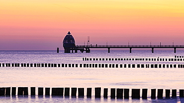 Groyne and diving bell with pier at the beach of Zingst at sunrise, Zingst, peninsula Zingst, Darss, Fischland, Baltic Sea, Mecklenburg-Western Pomerania, East Germany
