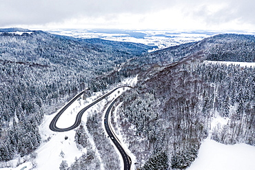Winter snow road serpentine curves aerial photo near Albstadt curve, Germany, Europe