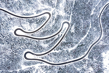 Road serpentines winter snow curves Lochenpass forest aerial photo curve, Germany, Europe