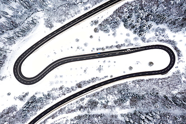 Road serpentines curves winter snow aerial photo curve, Germany, Europe