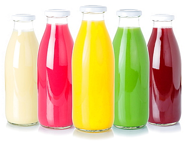 Various juices fruit juice drinks drink juice glass bottle cropped cutout isolated against a white background