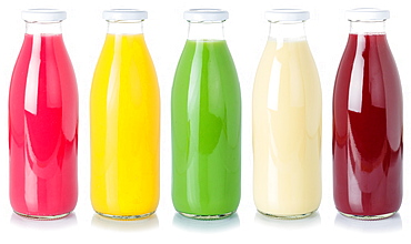 Various juices fruit juice drink juice glass bottle cropped cutout isolated against a white background