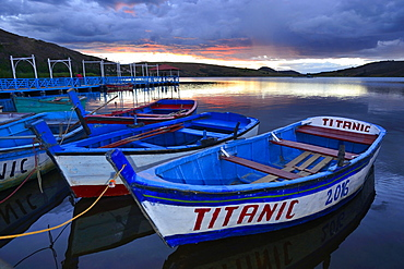 Rowboats on Laguna Sausacocha at sunset, Huamachuco, Sanchez Carrion Province, Peru, South America