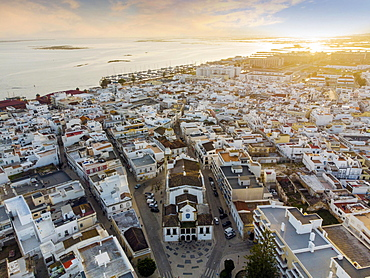 Aerial view of Olhao with a church in the foreground by sunset, Algarve, Portugal, Europe