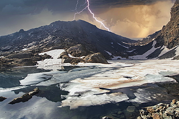 Thunderstorm at the lake Gele, iced lake, Mont Avic Natural Park, Aosta Valley, Italy, Europe
