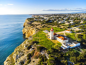 Cliffy coast of Algarve with Alfazinha Lighthouse in Carvoeiro, Portugal, Europe