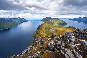 Mountain panorama, fjord and mountains, in the back mountain Segla, view from mountain Barden, Senja, Norway, Europe