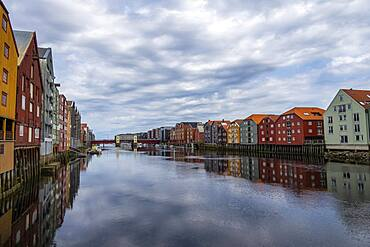 Colourful historic warehouses by the river Nidelva, Trondheim, Trondelag, Norway, Europe