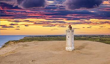 Sunset at Rubjerg Knude Fyr lighthouse, aerial view, North Jutland, Denmark, Europe
