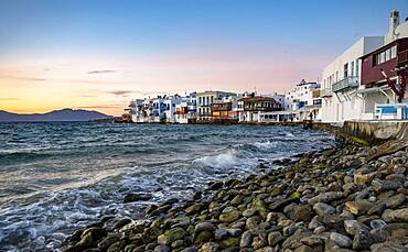 White Cycladic houses on the shore, Little Venice at sunset, Chora, Mykonos Town, Mykonos, Cyclades, Aegean Sea, Greece, Europe