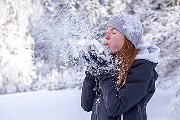 Woman enjoying the snow during winter walk, winter with snow, snowy landscape, Bad Heilbrunn, Upper Bavaria, Bavaria, Germany, Europe