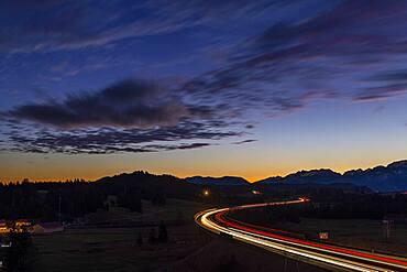 Motorway at blue hour with traces of cars in Allgaeu landscape, Seeg, Ostallgaeu, Bavaria, Germany, Europe