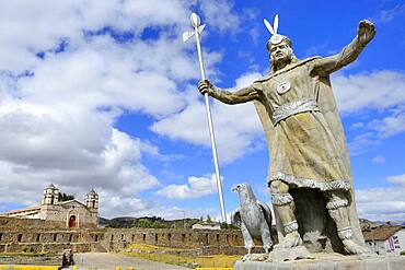Statue of the Inca Pachacutec in front of sun temple with attached cathedral from the colonial period, Vilcashuaman, Ayacucho region, Peru, South America