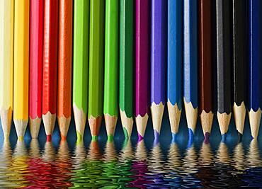 Crayons reflected in water