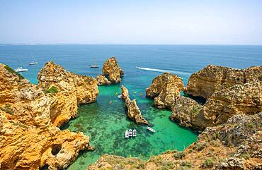Rugged rocky coast with cliffs of sandstone, rock formations in the sea, Ponta da Piedade, Algarve, Lagos, Portugal, Europe