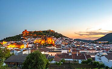 Town view of the village Aracena with illuminated fortress Castillo de Aracena, evening mood, Aracena, Huelva, Spain, Europe