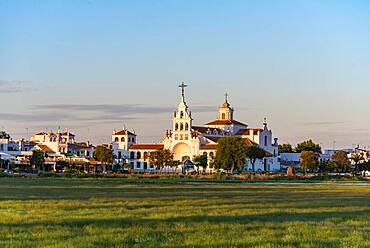 Village El Rocio with hermitage of El Rocio, hermitage Ermita del Rocio in the evening light, El Rocio, Almonte, province Huelva, Andalusia, Spain, Europe