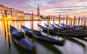 Evening atmosphere, sunset at the Grand Canal, gondolas at the pier, Campanile bell tower, Venice, Veneto region, Italy, Europe