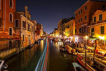 Canal with boats and historical buildings, light traces, Venice, Veneto, Italy, Europe