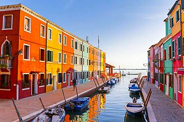 Canal with boats, Colorful houses, Colorful facade, Burano island, Venice, Veneto, Italy, Europe