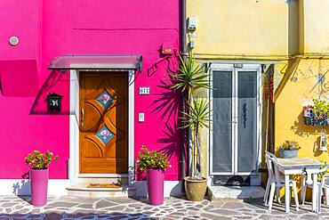 Two colorful houses, plants and table, colorful facade, Burano Island, Venice, Veneto, Italy, Europe