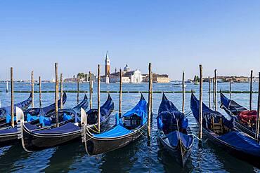 Venetian gondolas, behind church San Giorgio Maggiore, Venice, Veneto, Italy, Europe