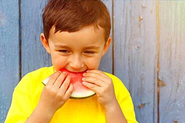 Summer watermelon child little boy eats, germany
