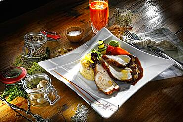 Turkey breast with sauce and risotto, served on a plate