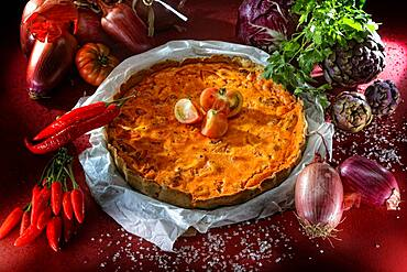 Quiche with tomatoes, red vegetable cake