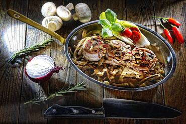 Pork tenderloin roasted with spaetzle in the pan