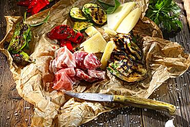 Antipasti with vegetables, cheese, sausage and ham