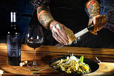 Woman with tattooed hands and fresh pasta