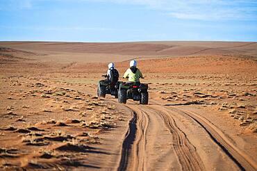 Quadbiker on sand track in the Namib, Namib Rand area, Namibia, Africa