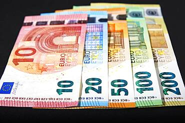 Various euro banknotes on black background, Germany, Europe