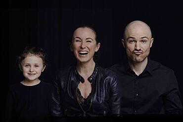 Family on black background