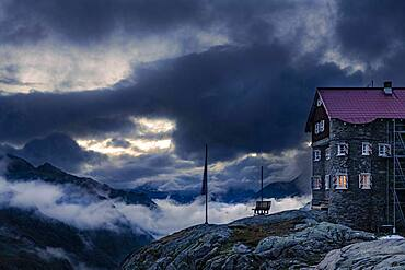 Siegerlandhuette at blue hour with dramatic cloudy sky, Soelden, Oetztal, Tyrol, Austria, Europe