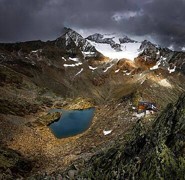 Hildesheimer Hut with Oetztal mountains and dramatic sky, Soelden, Oetztal, Tyrol, Austria, Europe